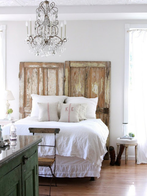 headboard made out of salvaged doors